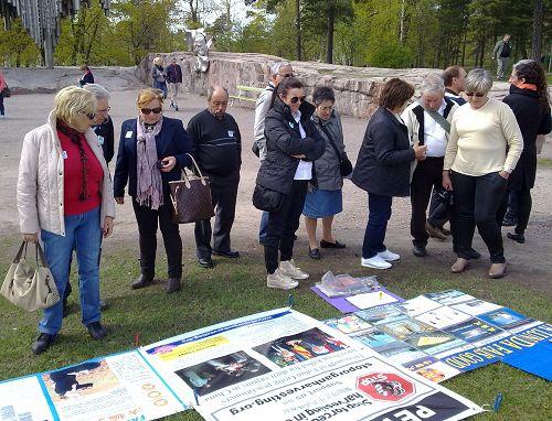 2014-6-6-minghui-finland-truth-spot-03